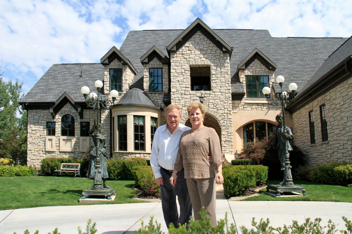 Dale and his wife Renae standing in front of their home in Sandy Utah.
